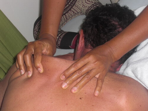 Receiving Thai Massage to release pain.